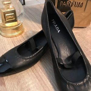 Prada black patent leather toe with kitten heel.